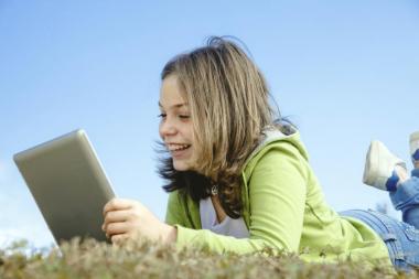 girl using digital tablet outdoors